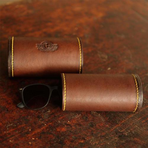The Ladysmith Spectacle Case, sunglasses, leather product, yellow stitching, logo